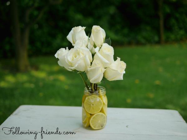 Lemon mason jar vase with white roses